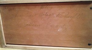Inscription on bottom of upper drawer