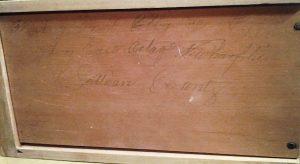 Inscription on bottom of upper drawer