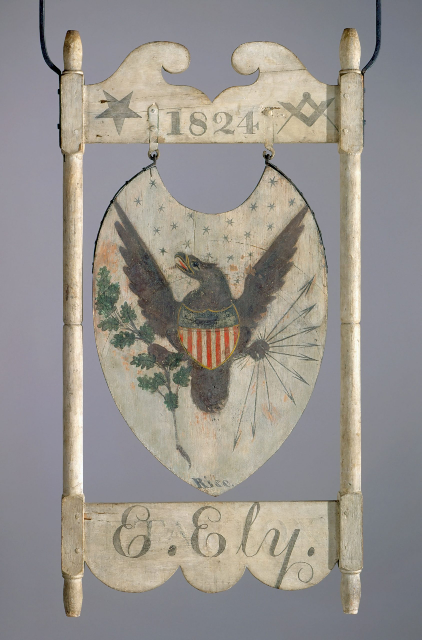 Sign for the <em>Tarbox Inn</em>, dated 1807 and 1824, Scantic, Connecticut. Side 2 overpainted possibly ca. 1831, Enfield, Connecticut. Paint on pine board and frame, sand, smalt, gold leaf, iron hardware, 50 ½ x 25 in. Innholders: Thomas Tarbox; Ephraim Ely; Isaac G. Allen. Signed by William Rice. Connecticut Historical Society, Hartford, Connecticut. Collection of Morgan B. Brainard, Gift of Mrs. Morgan B. Brainard, 1961.63.21.
