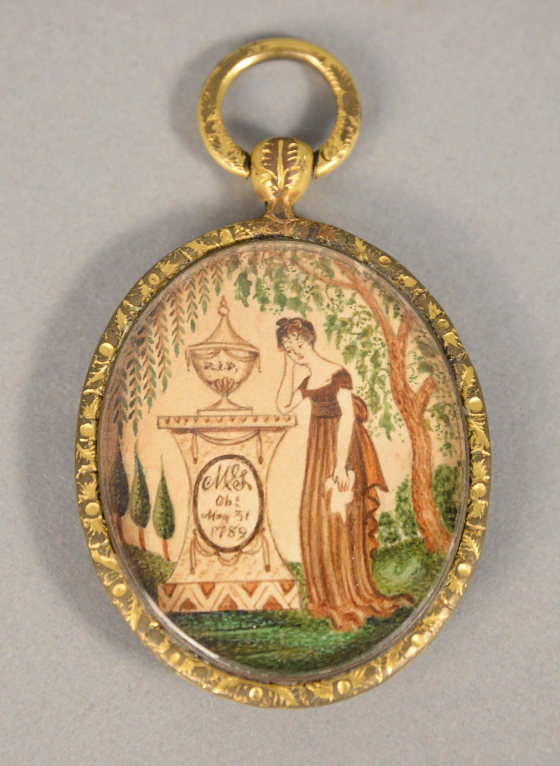 """Memorial pendant with miniature painting, inscribed """"MSL,"""" ca. 1810. Watercolor on paper. Photograph courtesy Nadeau's Auction Gallery, Inc., Windsor, Connecticut."""