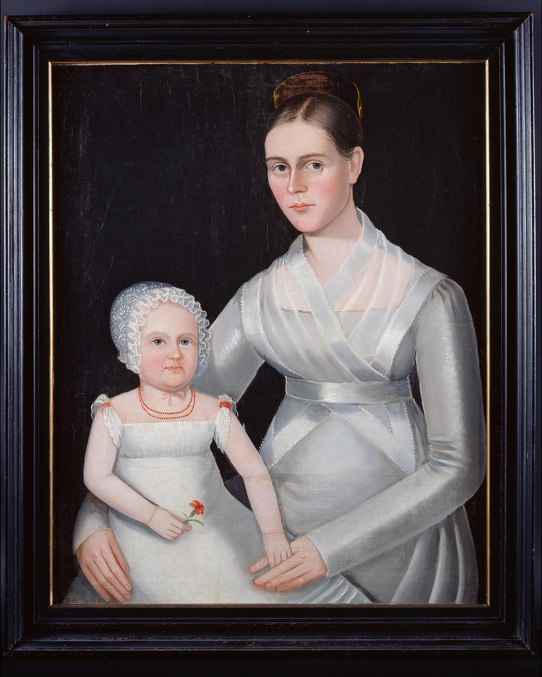 Attributed to Ammi Phillips (1788-1865), Mother & Child, ca. 1825. Oil on canvas, 39 × 33 ½ in (99.1 × 85.1 cm). Fenimore Art Museum, Gift of Stephen C. Clark, N0267.1961.