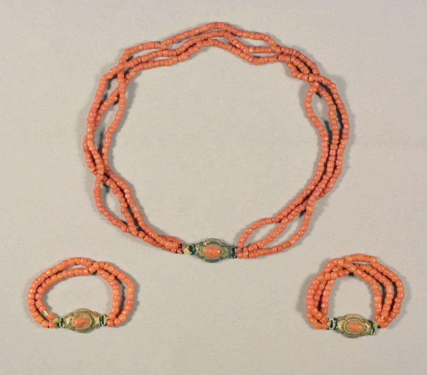 Coral bead child's necklace and matching armlets, Italy, ca. 1840-1880. Coral, gold. Historic New England, 1933.262.