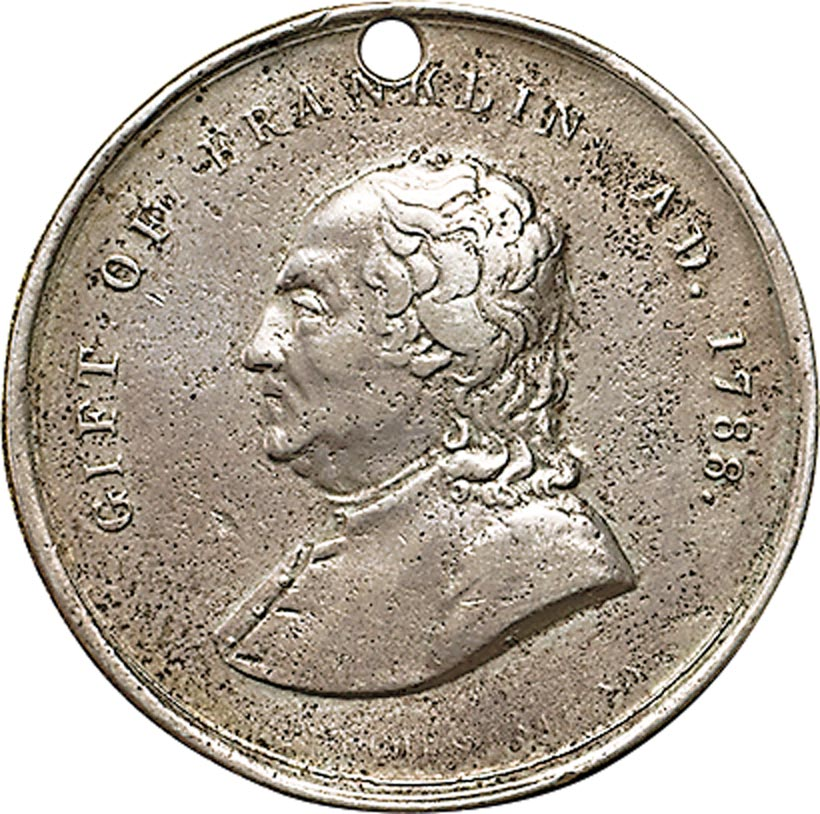 """Franklin medal for J.W. Atkinson, Boston, Massachusetts, 1843. Silver struck and engraved with hole for suspension, diameter 1 ¼ inches. Obverse: """"GIFT OF FRANKLIN / AD. 1788."""" Reverse: REWARD OF / MERIT BY THE / SCHOOL COMMITTEE / TO [engraved] J.W. Atkinson / 1843 / STIMPSON"""""""
